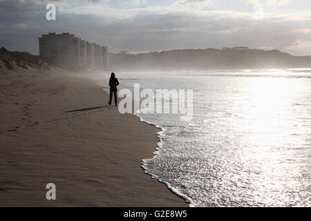 Girl Walking Along Seashore, Spain - Stock Photo