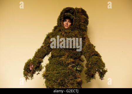 31 year old Vanesa Diaz waits fully dressed as a moss man before the Corpus Christi procession in Bejar. The legend - Stock Photo