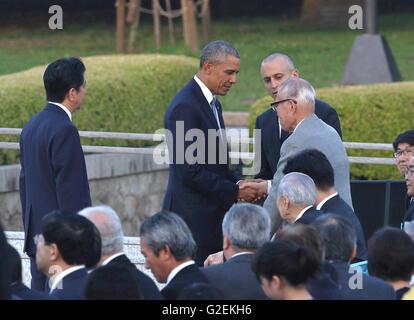 U.S. president Barack Obama talks with an atomic bomb survivor Shigeaki Mori at Hiroshima Peace Memorial Park in Hiroshima, Japan on May 27, 2016. © Motoo Naka/AFLO/Alamy Live News