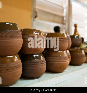 Horizontal close up of terracotta Canchanchara cups on sale at a pottery in Trinidad, Cuba. - Stock Photo