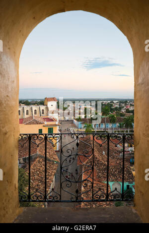 Vertical aerial view through a window of Plaza Mayor in Trinidad, Cuba. - Stock Photo