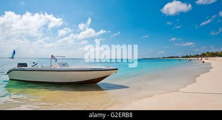 Horizontal panoramic (2 picture stitch) view of Playa Ancon near Trinidad, Cuba. - Stock Photo