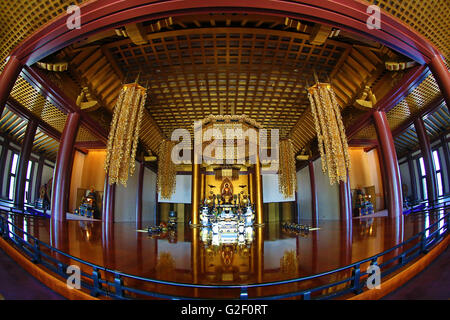 Interior of the Daiden (Hondo) the main hall of Zojoji Temple in Tokyo, Japan - Stock Photo