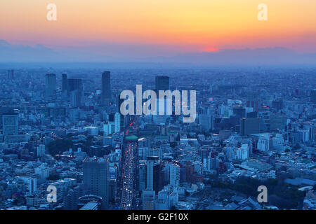 General city skyline sunset view of Tokyo, Japan - Stock Photo