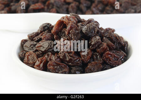 Bowl of raisin on white background - Stock Photo