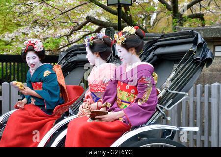 Maiko Sitting in Rickshaws - Stock Photo