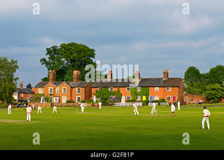 Game of cricket being played in the village of Hartley Wintney, Hampshire, England UK - Stock Photo