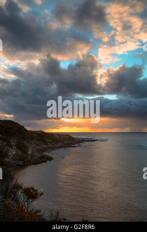 sunset over the surfing beach of Gracetown, Western Australia, Australia, dark storm clouds gathering overhead indicated - Stock Photo