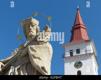 Jemnice, statue St. John Baroque church Unesco, Telc, Saint John of Nempomuk, statue, holding cross, Southeastern - Stock Photo
