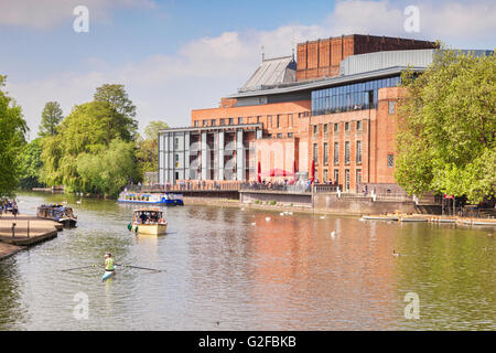 Royal Shakespeare Theatre and the River Avon and  people in boats on the river on a sunny weekend in late spring, - Stock Photo