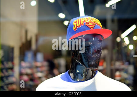 Mannequin with Superman baseball cap in a store window. - Stock Photo