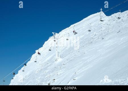 Ski lift on Hintertux glacier nearby Zillertal valley in Austria - Stock Photo