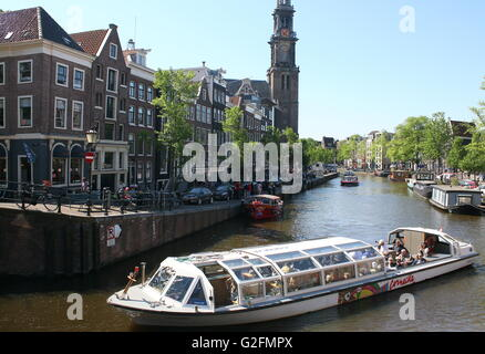 Canal boat on Prinsengracht canal. In background Anne Frank House & historical 17th century Westerkerk, Amsterdam, - Stock Photo