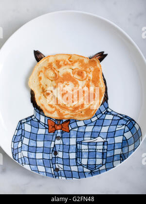 Pancake with face on owl plate - Stock Photo
