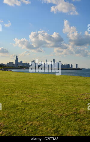 View of the skyline of Chicago from the lake front park and bike trail on the south side in the Kenwood neighborhood. - Stock Photo
