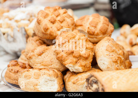 home made brown tasty buns on plate - Stock Photo