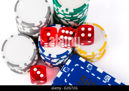 Four  red dice with colored casino chips isolated on white background - Stock Photo