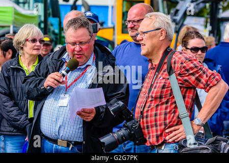 Emmaboda, Sweden - May 14, 2016: Forest and tractor (Skog och traktor) fair. Photographer and speaker with microphone - Stock Photo