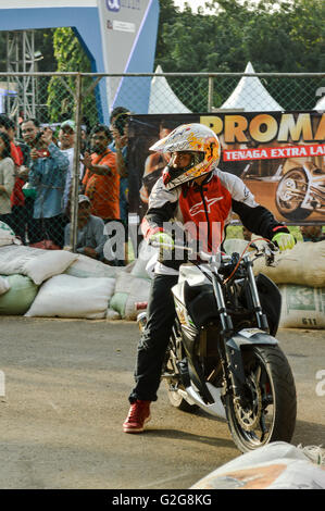 Stuntman  in automotive event tumplek blek 2016, Jakarta, Indonesia - Stock Photo