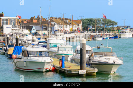 Boats moored on the River Arun in Littlehampton, West Sussex, England, UK. - Stock Photo