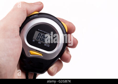 New digital stopwatch ina ahand isolated on white background showing zero on lcd screen - Stock Photo