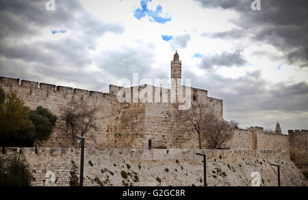 David tower in jerusalm stone boundry wall with cloudy skyes - Stock Photo