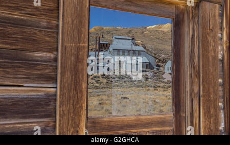 Reflection of old factory in Bodie State Historic Park - Stock Photo