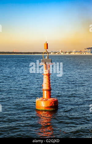 Navigation red buoy at the edge of a fairway. - Stock Photo