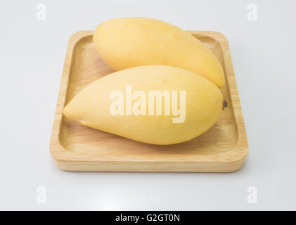 fresh delicious yellow mango in wood plate  isolated  on white background - Stock Photo