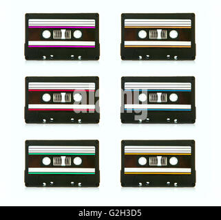 6 vintage compact cassette audio tapes on a white background - Stock Photo