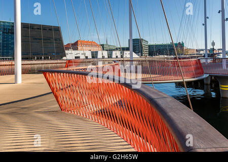 Close up of the Circle Bridge spanning Christianshavn Canal, The Black Diamond in the background, Copenhagen, Denmark - Stock Photo