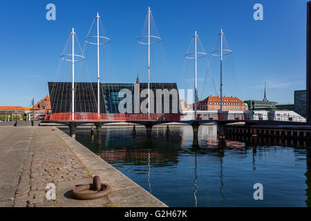 The Circle Bridge spanning Christianshavn Canal, The Black Diamond in the background, Copenhagen, Denmark - Stock Photo