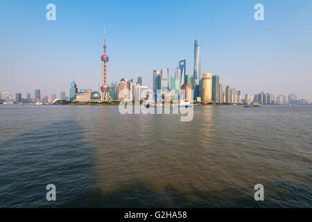 Shanghai, China -  Oct 11,2015: The Huangpu river and the skyline of Pudong business district in Shanghai, China. - Stock Photo