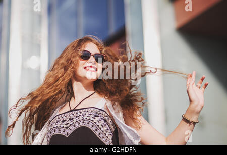 Young redhead woman smiling - Stock Photo