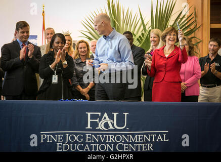 West Palm Beach, Florida, USA. 31st May, 2016. Rep. Gayle Harrell (right) celebrates after Gov. Rick Scott signs - Stock Photo