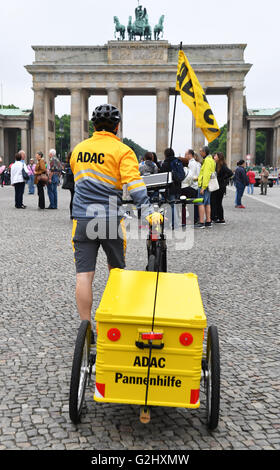 Road patrol driver Dirk Niessl rides his e-bike at a press event at the Pariser Platz in front of the Brandenburg - Stock Photo