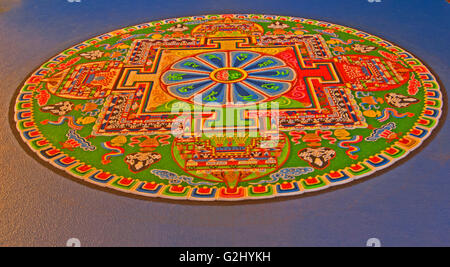 The Green Tara Mandala, created by monks by methodically blending rainbow-colored  sand pebbles over intricate circular - Stock Photo