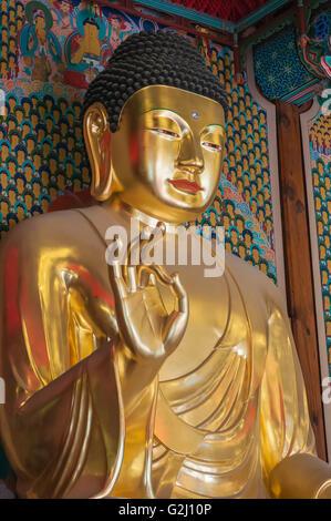 Golden Buddha statues inside the Daeungjeon, Main Dharma Hall, Jogyesa, Seoul, South Korea - Stock Photo