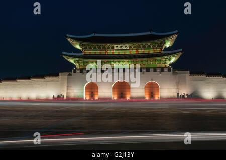 Gwanghwamun, main gate, with motion blur traffic at night, Gyeongbokgung Palace, Jongno-gu, Seoul, South Korea - Stock Photo