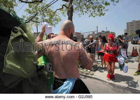 Tattooed bodybuilder man being photographed by Siren Sailor, Pre-Coney Island Mermaid Parade, Brooklyn, NY, © IndyFoto - Stock Photo