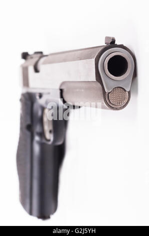 Silver color pistol closeup isolated on white background - Stock Photo