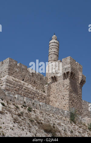david tower in jerusalem boundry wall  with blue sky - Stock Photo