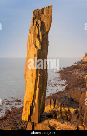 Balancing Rock - a columnar basalt stack on Long Island at Tiverton, Nova Scotia, Canada - Stock Photo