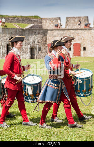 Musical procession at the Fortress of Louisbourg National Historic Site of Canada in Louisbourg, Nova Scotia - Stock Photo