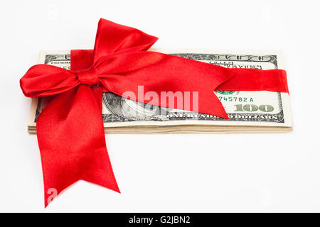 dollars wrapet up with a red ribbon isolated on white background - Stock Photo