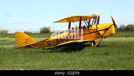 a yellow Tiger Moth aircraft at an airfield in Yorkshire, UK - Stock Photo