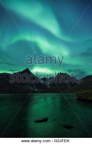 Three green streaks of the aurora borealis above Grizzly Lake, Tombstone Territorial Park, Yukon Territory, Canada - Stock Photo