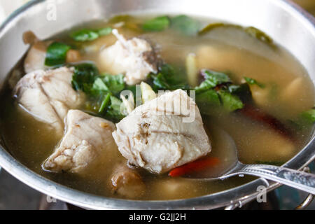 Spicy hot and sour soup (Tom yum) with grouper. - Stock Photo