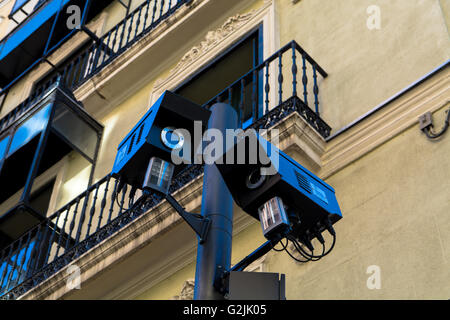 Low Angle View Of CCTV Security Cameras Against Building In Street - Stock Photo