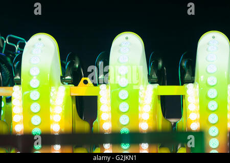 Detail of rollercoaster lights in the amusement park at night. - Stock Photo